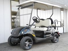 This brand new street-ready 2013 Yamaha DRIVE PTV fuel-injected gas golf car features the Black Onyx Metallic paint, 12-inch Venom concave alloy wheels, 205/30-12 Excel Golf Pro Low Profile DOT-rated performance street tires, American-made rear flip seat with rear safety bar & powder coated aluminum frame, and an extended hard top with integrated enclosure tracks.