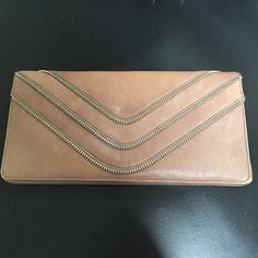 Nordstrom clutch Nordstrom clutch in tan distressed leather with zipper detailing. Magnetic pouch on back.  Three compartments on inside, plus two zippered pouches and 13 slots for cards. Magnetic closure. Nordstrom Bags Clutches & Wristlets