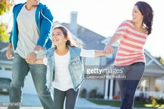 Happy family holding hands and running