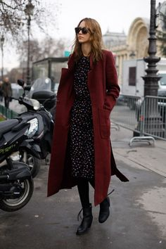 i know this is a minor detail, but i really like the idea of a red trenchcoat -- the city's grey and boring, life can be dull and bleak, but there's a spark of color and life in her coat.