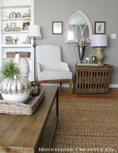 Honeycomb Creative Co.: House Tour.  Wood floor, sisal rug, sofa, sofa table, book case styling, old chest, accessories