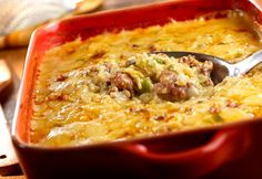This sausage and rice casserole is seasoned with onions, green peppers and a creamy sauce...when youre in the mood for something especially tasty, give this dish a try!
