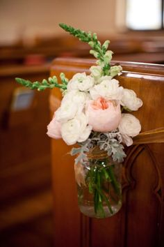 Jam jar style pew ends with matching bridal flowers.
