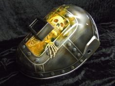 """""""Darkness"""" themed welding helmet airbrushed with riveted metal plates, realistic flames and creepy skeleton (left side)"""