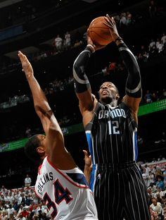 Dwight Howard #12 of the Orlando Magic shoots over Jason Collins #34 of the Atlanta Hawks. 2011 NBA Playoffs.