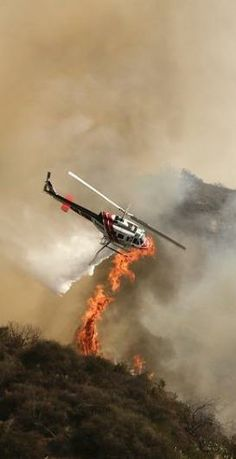 A helicopter fighting a wild fire outside of Azusa, California.