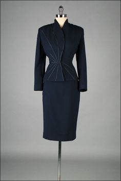 Love this suite! The trim detail would be cool in reflective fabric trim. ->Vintage 1950s Suit . LILLI ANN