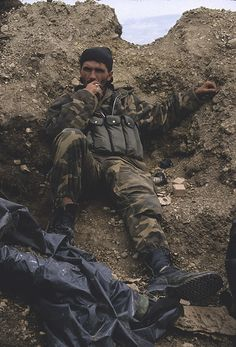 Near Vitez, Bosnia    A Croatian soldier takes a break during a lull in the fighting at the sandpit.    James Mason