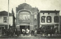 The fire station on Second Street, Chillicothe, Ohio around 1910. Two horse-drawn ladder trucks are visible; the pumper may be drawn by the team in the center.