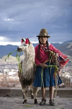 Peru - Andes Mountains - Inca Indian woman with a llama (or is it a Alpaca or Vicuna?)