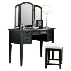 5-drawer vanity with a tri-fold mirror and stool with turned fluted legs. Product: Vanity, mirror and benchConstruction M...