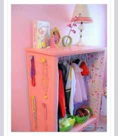 Take out the the drawers from a Chester drawer, add some knobs on side & you have a dress up closet