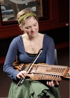 The nyckelharpa is a Swedish instrument with 16 strings and 37 keys. The keys slide under the strings to dampen or fret them by reaching up to the string; the strings are played with a bow. The earliest evidence of a nyckelharpa is an image dating back to 1350 C.E. and the oldest existing instrument was built in 1526 C.E. Pictured is nyckelharpa player Bronwyn Bird.