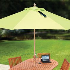 The market umbrella is green, not only for its color, but its solar panels that can convert sunlight into electricity!
