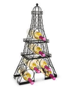 "Eiffel Tower Wine Rack from WineRacks.com  Display your fine bottles of wine in the Eiffel Tower Wine Rack. Its crossing metal member construction creates a mesh work that is very strong, and looks just like the actual Eiffel Tower. For compact shipping it is also modular, breaking down into three sections. Accommodates 6 bottles of wine.  Dimensions: 15 3/8"" x 27 1/2"" x 7 1/8"""