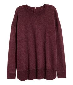 Burgundy melange. Sweater in a soft, fine knit with wool content. Dropped shoulders, long sleeves, visible zip at back, and ribbing at cuffs and hem.