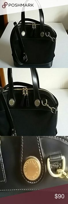 DOONEY BOURKE  purse. This is very nice Satchel /Shoulder purse. Genuine leather upper and bottom with heavy canvas in between.   The shoulder strap is removable. One drop-in pocket inside. Like new condition. Dooney & Bourke Bags Satchels