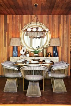 Kelly Wearstler beach house dining room wood paneling Platner chairs