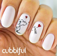I love these snoopy nails because who doesn't like snoopy? He's adorable