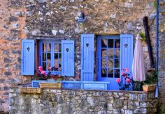 Beautiful blue window and door window in stone house at Coursegoules, Alpes-Maritimes ~ love the bright blue shutters and deep pink flowers