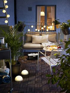 Liven up a small patio with plants, solar-powered lighting and outdoor seating.  hanging globes start at