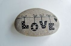 """love"" ~ Pebbles of Portugal ~ collected on the beaches around Cascais and hand painted by Sabine Ostermann"