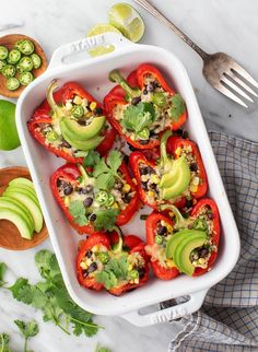 This easy stuffed peppers recipe is destined for your regular rotation! It's made with a zesty rice, black bean, and corn filling. Top the peppers with cheese, or skip it, and serve them with guacamole or chipotle sauce for a vegan variation. | Love and Lemons #stuffedpeppers #dinnerideas #vegetarian #healthyrecipes Taco Side Dishes, Vegetable Side Dishes, Stuffed Peppers With Rice, Parsnip Puree, Twice Baked Sweet Potatoes, Veggie Skewers, Simple Green Salad, Cilantro Lime Rice, Vegetarian Recipes