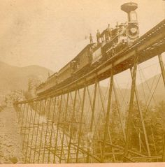 """http://www.conwayscenic.com.   When it was completed in 1875, the Frankenstein Trestle (no, it was not named after Mary Shelley's monster!) in NH's Crawford Notch was considered an engineering marvel.  Then part of Maine Central RR's famed """"Mountain Division Line,"""" it has been reinforced several times and still makes passengers on our modern-day """"Notch Train"""" gasp with wonder!   It is now part on the """"Notch Train"""" route of the Conway Scenic Railroad.  (From the photo collection of Dwight…"""