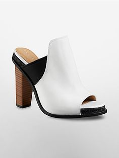 77f1b56cafa4 this high heel mule features a slip-on style and colorblock pattern. Heeled  Mules