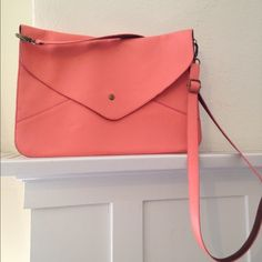 "Beautiful coral shoulder/crossbody envelope purse Envelope style purse, with magnetic closure, faux leather, back zipper, approx 23 in. drop. Measures 9 1/2"" height, 14"" length. I purchased from a local designer in my city...beautiful bag wore once. Freelance designer Bags Crossbody Bags"