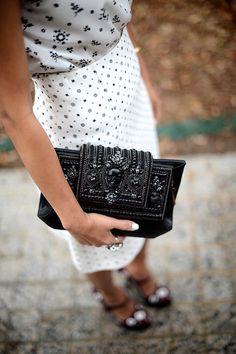 Miu Miu blouse and skirt, Prada Pumps, Beavaldes skull clutch #StreetStyle