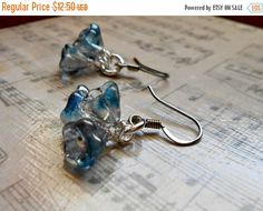 ON SALE Crystal Blue Luster Fire Polished Czech Flower Bells Wire Wrapped Dangle Earrings, Bridesmaid, Bridal, Perfect Gift for Her by HandmadebyJulesnkc on Etsy https://www.etsy.com/listing/211389909/on-sale-crystal-blue-luster-fire