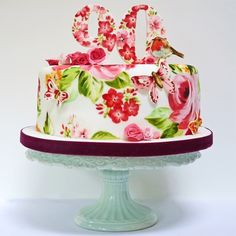 Robin cake - A painted cake with a robin and geranium flowers for a 90th birthday