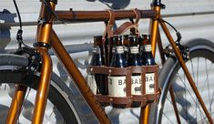 Leather Bicycle Beer Carrier by Fyxation - looks nice but it'd kill pedalling