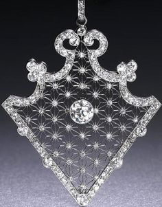 A Belle Epoque diamond brooch/pendant, circa The articulated triangular openwork plaque, centrally-set with a collet-set old brilliant-cut diamond, within star-shaped latticework accented by single-cut diamonds, to a scrolled border millegrain-set t Bijoux Art Nouveau, Art Nouveau Jewelry, Jewelry Art, Fine Jewelry, Jewelry Design, Jewelry Sites, Geek Jewelry, Belle Epoque, Edwardian Jewelry