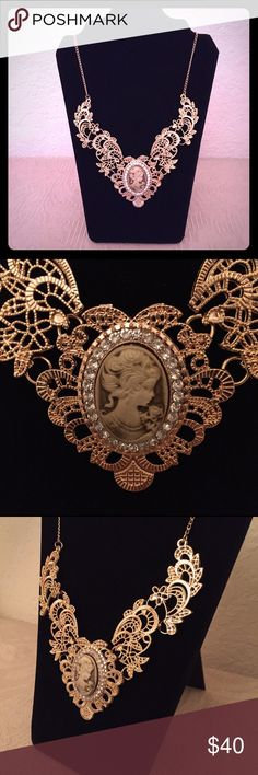 "Vintage Victorian Style Cameo Gold-Plated Necklace This stunning necklace is both unique and beautiful. Photos do not do it justice! The metal lace is plated in 18k yellow gold with an adjustable length of 16-22"". Would make an excellent gift or treat for yourself! NWOT Jewelry Necklaces"