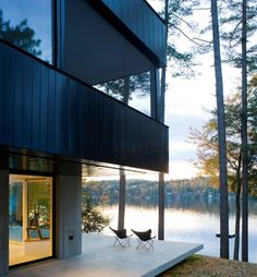 Cantilever Lake House in Dunmore, Vermont, a project by Brian Mac - Vermont Architects. The house is clean and elegant. Cement floor, a lot of white elements, glass and wide spaces create an awesome environment.