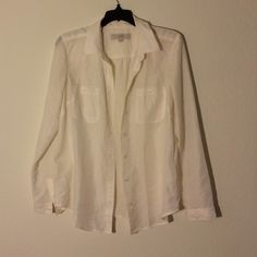 All white button up top All white with buttons and front pockets. No flaws, size small. Please use the offer button for single items. No holds and no trades. LOFT Tops Button Down Shirts