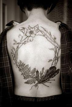 Natural Tattoo Art on Back http://www.pairodicetattoos.com/natural-tattoo-art-on-back/