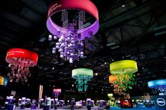 Above the Solutions Showcase, colorful, chandelier-like signage indicated the five topical areas of the floor.