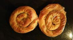 Homemade, hand rolled Tiropita with giagia..Greek feta cheese Pita..mini circles for lunch..