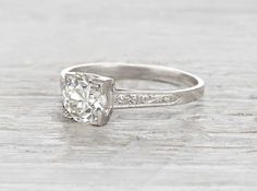 Vintage Art Deco engagement ring made in platinum and centered with an EGL certified 1.22 carat old European cut diamond. Circa 1920