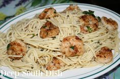 Pan Seared Shrimp and Scampi Pasta - Garlic and butter scampi pasta with white wine, fresh herbs, lemon and red pepper flakes, tossed with seasoned, pan-seared shrimp.