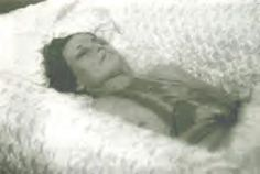 Bonnie Parker (of Bonnie and Clyde) in her casket. Death photos were popular in the early part of the  last century, and especially so with someone of her notoriety.