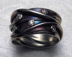 Ring by James Morton. Diamonds set on 14k white gold with iridescent patinas.