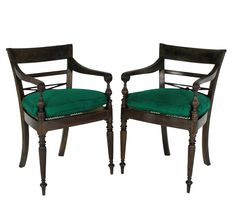 A pair of elegant Anglo-Ceylonese open armchairs in fumed teak, with nicely turned legs and scroll arms. With newly caned seats and feather pads in emerald silk. c.1880 Measure: 84cm high (backs) x 57cm high (seats) x 56cm wide x 55cm deep   Stock Code ET02340