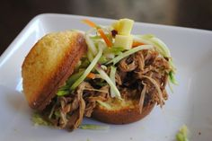 Slow Cooker Chipotle Pork with Mango Slaw -- maybe use with pioneer womans dr pepper pulled pork instead?