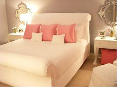 light grey walls, white bedding and light pink accents
