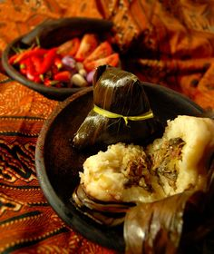 Bacang, Indonesian traditional snack made of steamed rice with chopped meat or soybean filling wrapped with bamboo leaves. bacang2 (by cookingtime)