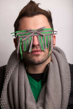 """GIACOMO FAVILLA, an Italian photographer, explores our role in pollution & the creation of waste in """"Anonymous"""", a series of photographic portraits. The images poignantly portray how people choose to be blind to the damage being done to the environment. Subjects are wearing sunglasses assembled from objects usually thrown away without a second thought. Favilla collaborated with designer Rossella Bessi to create the glasses. The photographs were recently shown for the 1st time in the UK"""